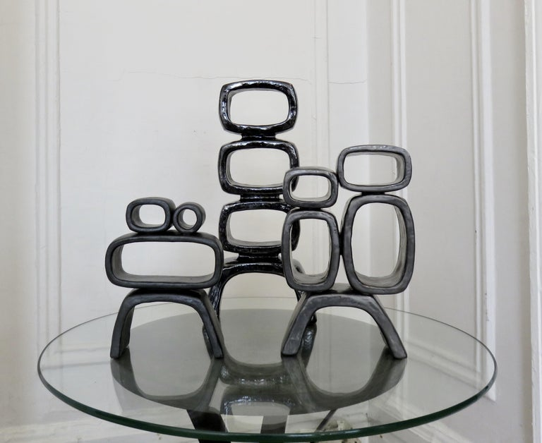 Ceramic Sculpture With 5 Hollow Rings on Angled Legs, Black With Metallic Specks For Sale 13