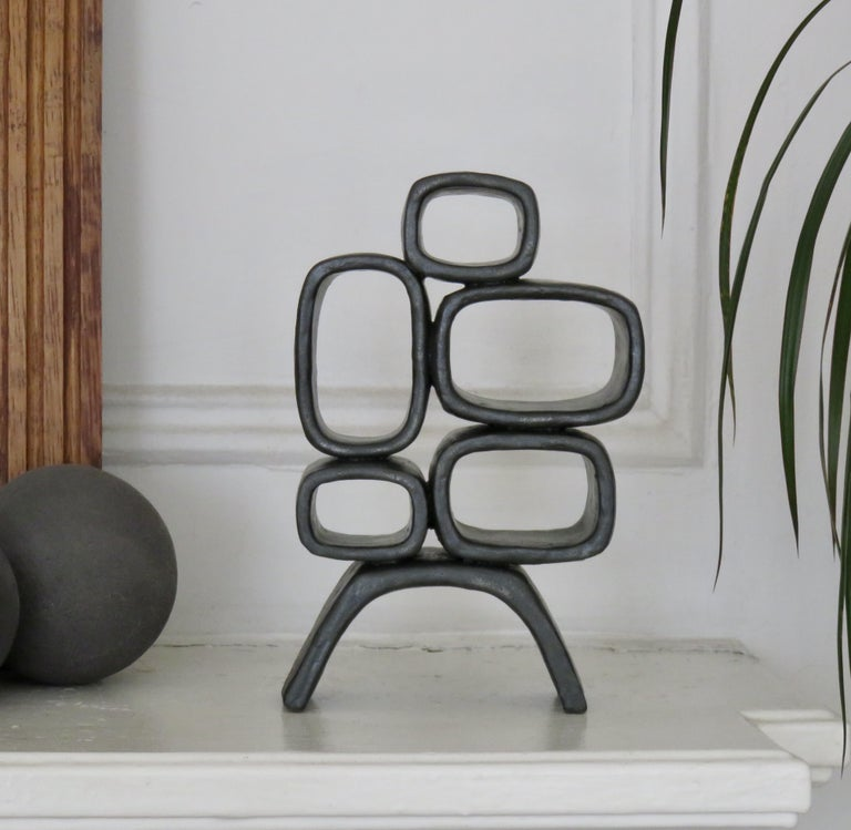 Organic Modern Ceramic Sculpture With 5 Hollow Rings on Angled Legs, Black With Metallic Specks For Sale