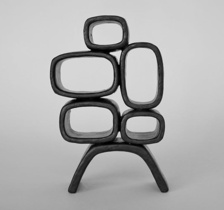 Glazed Ceramic Sculpture With 5 Hollow Rings on Angled Legs, Black With Metallic Specks For Sale