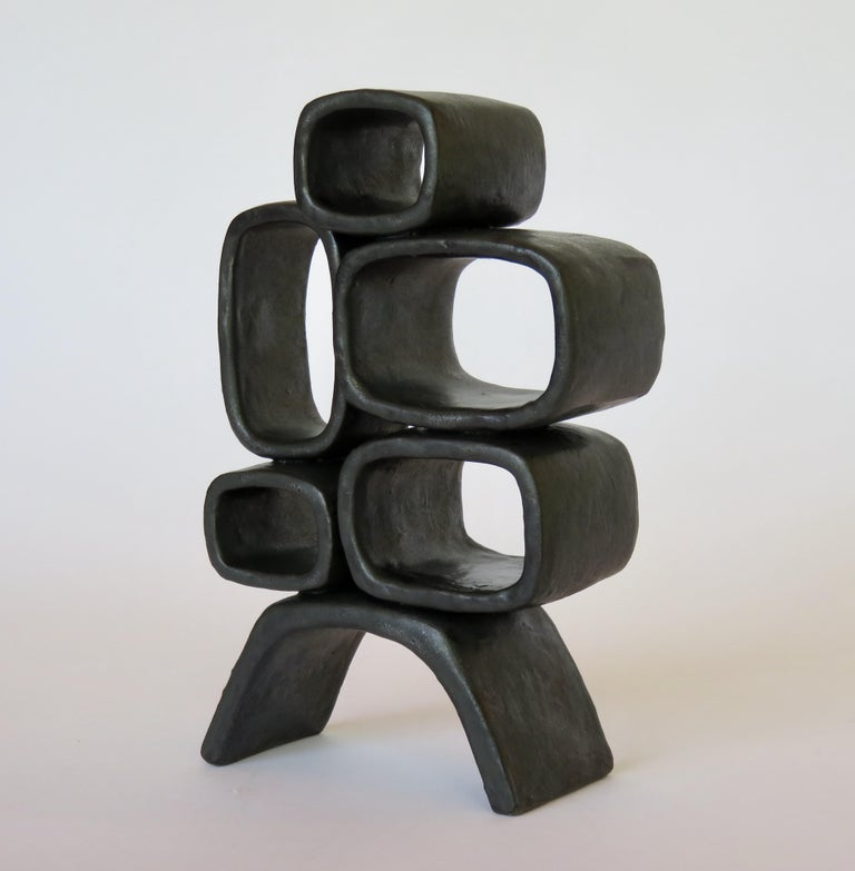 Contemporary Ceramic Sculpture With 5 Hollow Rings on Angled Legs, Black With Metallic Specks For Sale