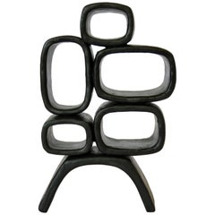 Ceramic Sculpture With 5 Hollow Rings on Angled Legs, Black With Metallic Specks
