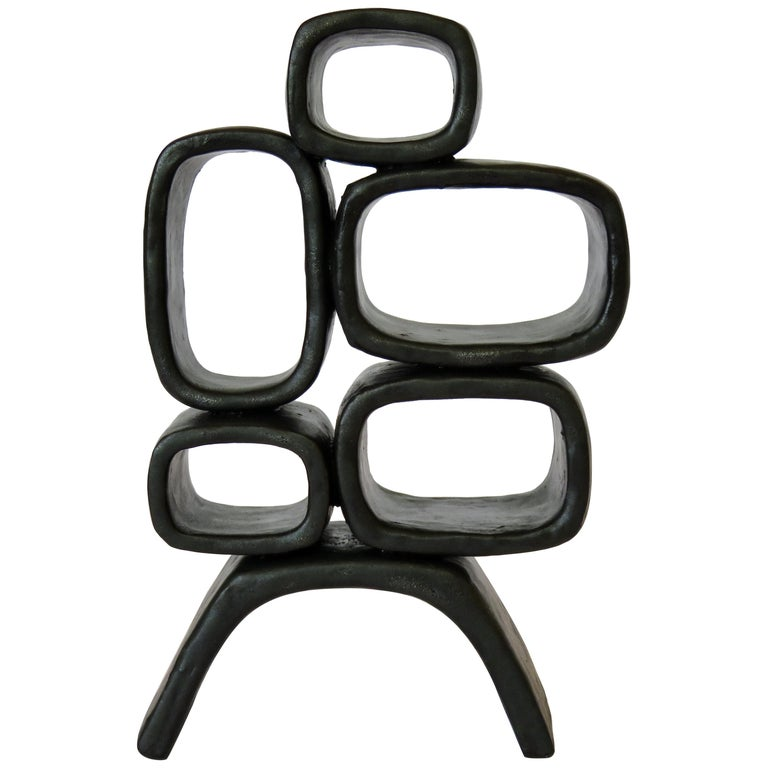 Ceramic Sculpture With 5 Hollow Rings on Angled Legs, Black With Metallic Specks For Sale