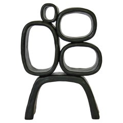 Metallic Black Hand-Built Ceramic Sculpture with Hollow Rings on Angled Legs