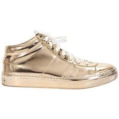 Metallic Gold Jimmy Choo Mid-Top Sneakers