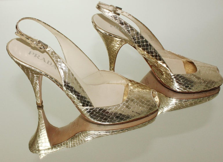 Beautiful peep toe high heels by Prada  Metallic golden color Slingback adjustable  Size 38.5 EU  Comes with PRADA dustbag