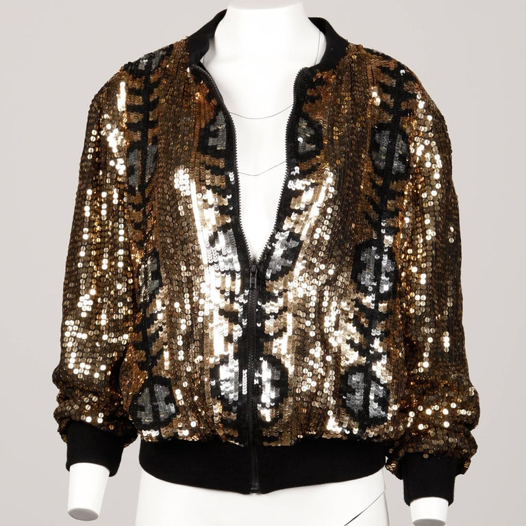 Unworn with the original store tags attached! Vintage sequin bomber jacket with ribbed cuffs and waistband and zip up front. The jacket is 100% silk with polyester lining. The marked size is a large but the jacket should fit sizes small-medium as