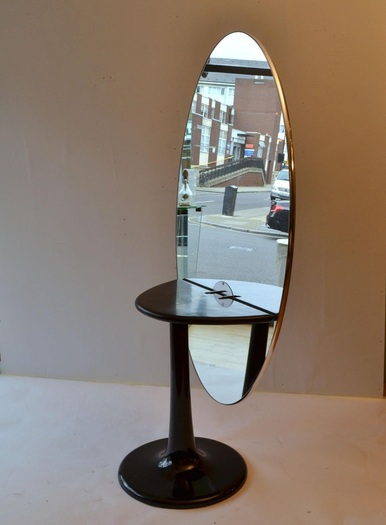 Metamorphic Oval Black Glass Table Transforms to Full Length Oval Vanity Mirror In Excellent Condition For Sale In London, GB