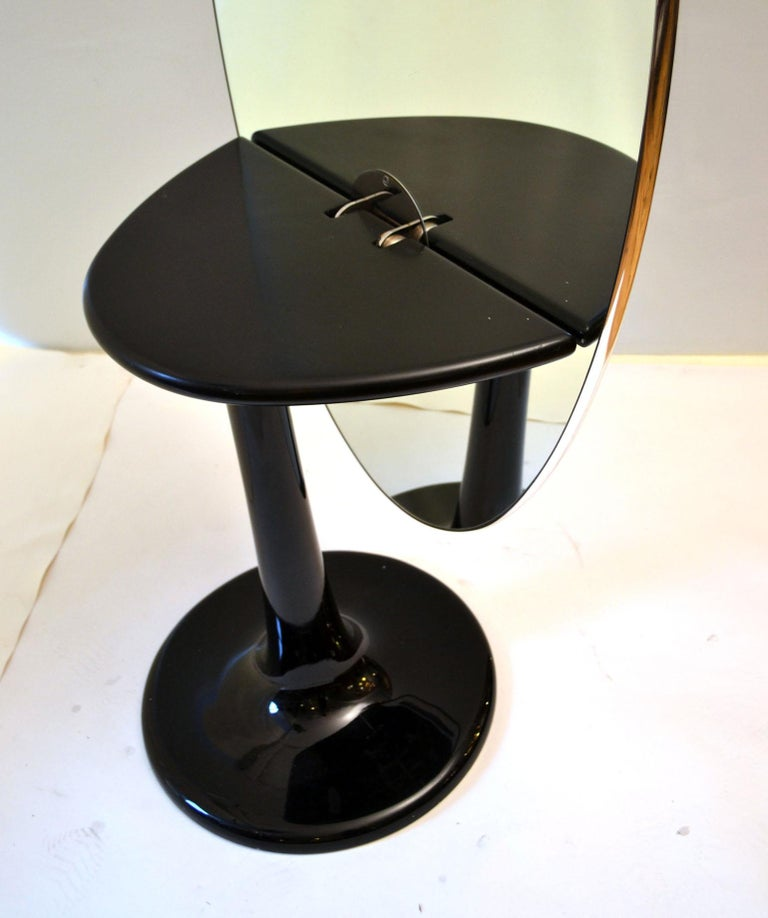 Metal Metamorphic Oval Black Glass Table Transforms to Full Length Oval Vanity Mirror For Sale