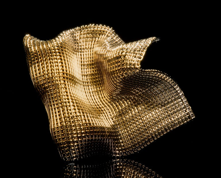 Metamorphosis I, is a unique gold and glass sculpture by the British artist Cathryn Shilling. Using her signature woven glass 'fabric' technique, Shilling layers kiln formed glass cane to create this beautiful latticed artwork, which has been