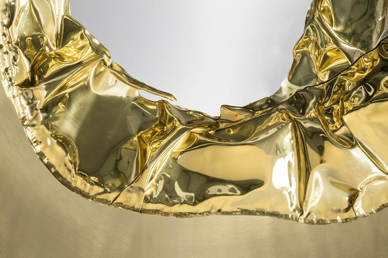"""1. Product description:  The """"Meteor"""" wall mirror's frame consists of 2 different parts, the inside part is accomplished by an artisan who smashes a brass plate to get this wrinkled effect. The outside brass plate part is hand-polished for hours"""