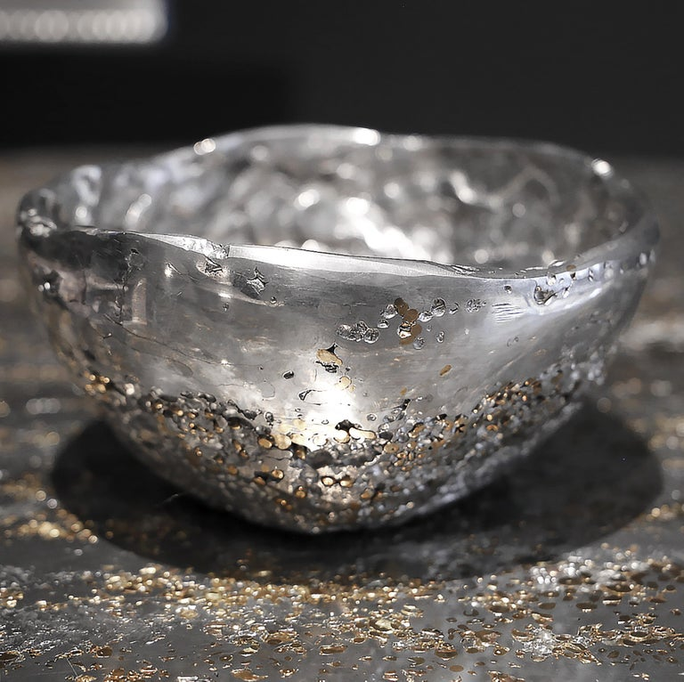 """In stock. This contemporary cup is a unique piece, created by Xavier Lavergne and made of melted pewter with brass grains. It seems like a Meteorite discovered in the sand. Handmade in France and sold with its """"Certificate of Authenticity"""", this"""