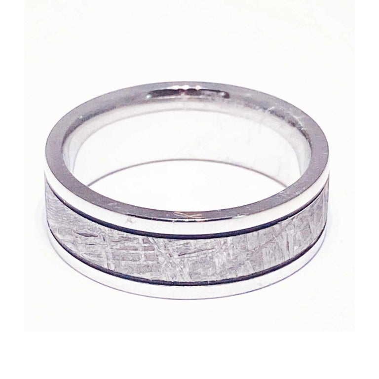 This ring is perfect for a person that is out of this world amazing! The custom unisex wedding band has genuine Meteorite inlay on the top of the ring, going all the way around in a seamless design. The genuine Meteorite has a unique, distressed