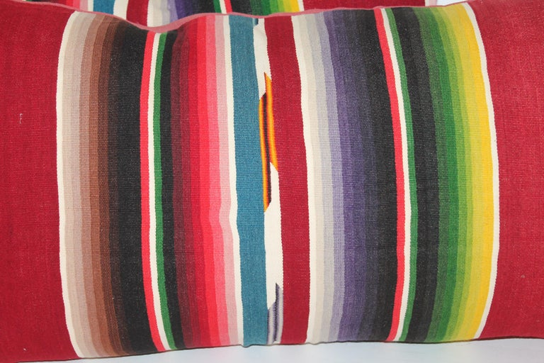 These Mexican Indian weaving's made from a serape. The condition is very good with cranberry cotton linen backings. There are two pairs in stock. Sold in pairs.
