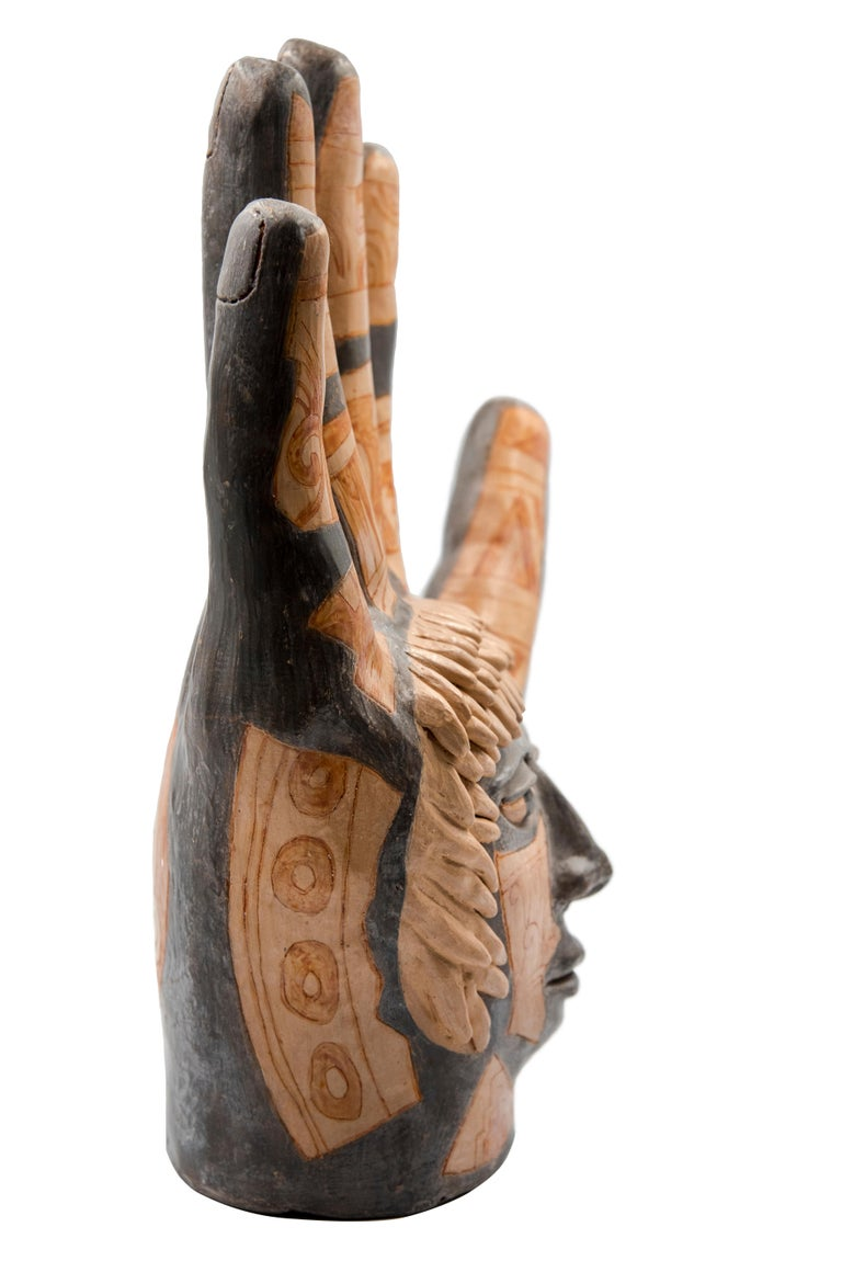 This Mexican ceramic clay hand sculpture is a piece by artist Manuel Reyes. Made with clay from Oaxaca and Zacatecas, painted with oxides from the region. Done with the hand-modeled technique and cooked in traditional wood-fired oven. The hand is