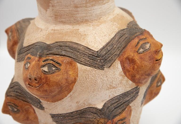Late 20th Century Mexican Ceramic Jug with Faces Dolores Porras Folk Art Decorative Vessel For Sale