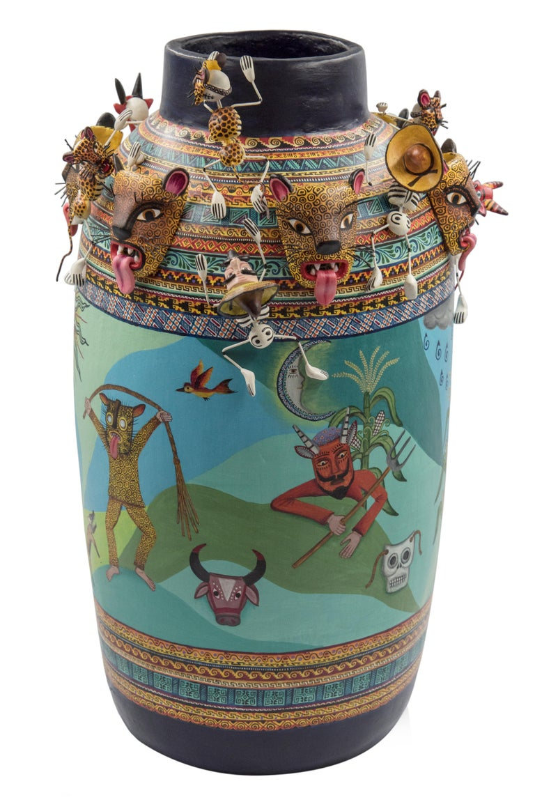 Beautiful Mexican ceramic vase made with cooked clay and decorated with acrylic paint.  The vessel represents the traditional dance for the good harvest and fertility, practiced still in some small Mexican towns. One of the main characters in the