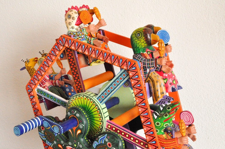 "This colorful fortune wheel alebrije is made by Agustín Cruz Tinoco in Oaxaca Mexico.   ""I came up with the idea as a toy for children,"" says Mexican master wood carver Agustin Cruz Tinoco.  As Mr. Agustin watches children and their imaginations run"