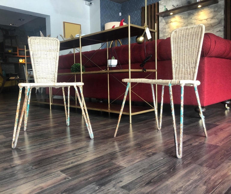 Iron and caned chairs, the seat and backrest are handmade with cane, the painting is original and apparently over time they were painted a couple of times, the original vintage finish of the legs looks great.