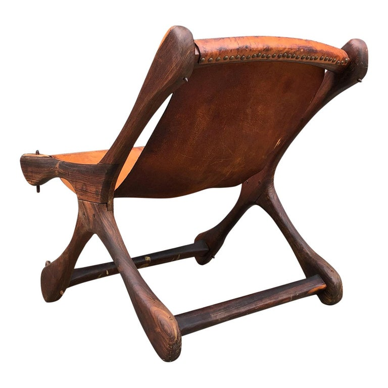 Wonderfully crafted lounge chair in rosewood / Cocobolo (one of the finest woods in the world). All original, some patina/cracking to the brown leather. Don S. Shoemaker is the most important and praised Mid-Century Modern furniture designer from