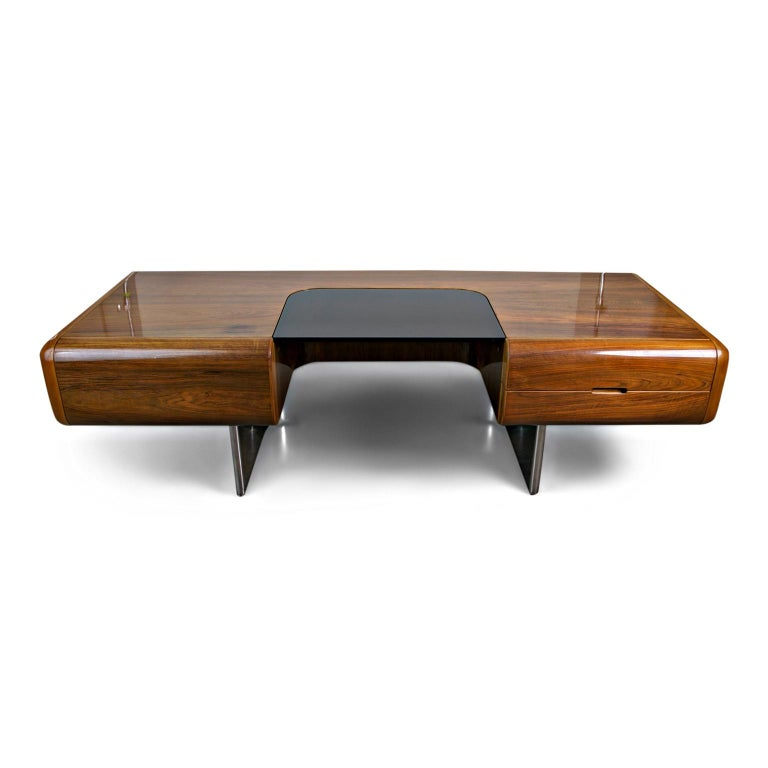 An incredibly rare, special and massive Executive Desk designed by M. F. Harty and produced by Stow Davis as part of the