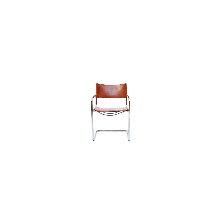 Brown leather MG5 chair by Marcel Breuer. This chair was designed in 1928 for Italian editor Gavina. Chairs are in a good vintage condition. Wear consistent with age and use. Two available.