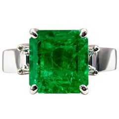 Certified 4.9 Carat Colombian Emerald and Diamond Three-Stone Ring