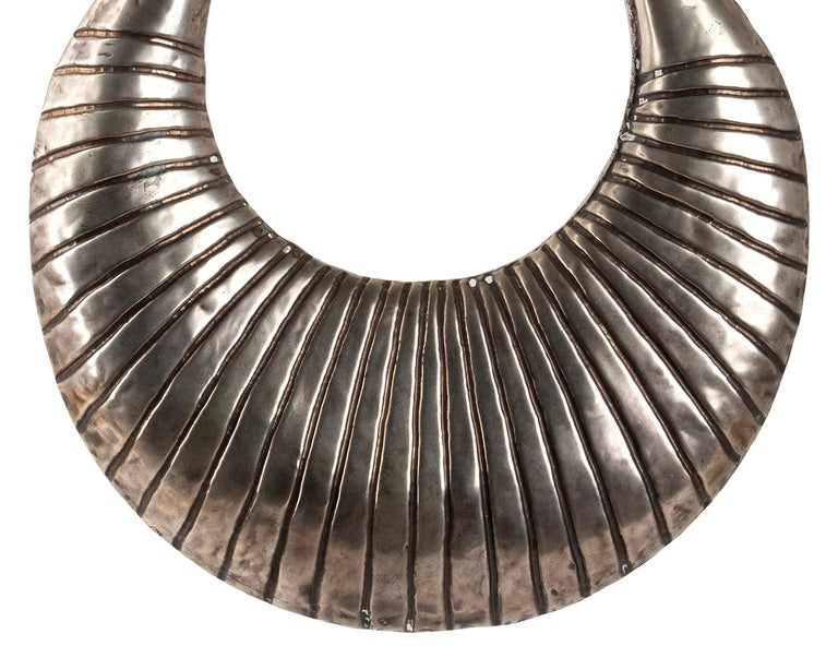 This is a Miao silver ceremonial necklace, realized in Laos between late 19th-early 20th century  From the HMong Village