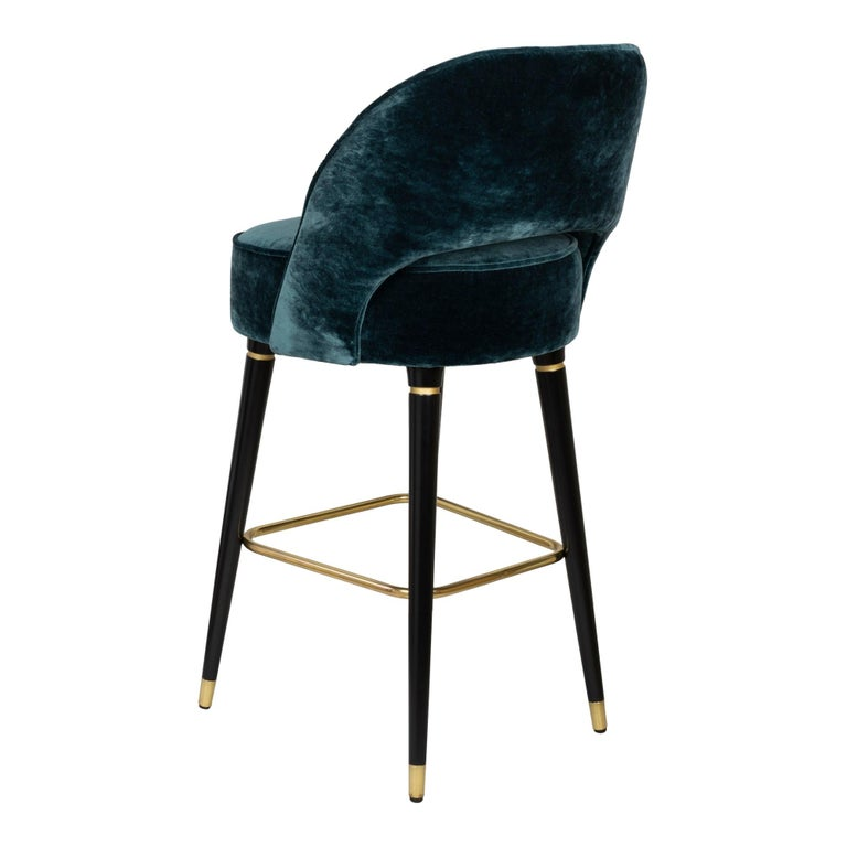 Bar stool with walnut, oak or ash legs and fully upholstered seat and back. Available in counter or bar height. Seat Height: 30? (Available in counter seat height 26? or custom height) COM available.