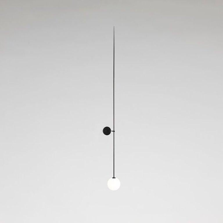 Mobile chandelier 10 Manufactured by Michael Anastassiades London, 2015 Black patinated brass, mouth blown opaline spheres  Measurements: 15 cm x 193 H cm 5,9 in x 76h in  Concept The studio's philosophy is a continuous search for
