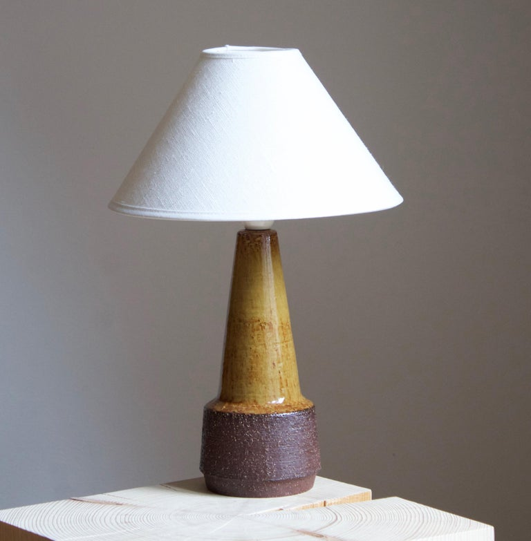 A table lamp produced by Michael Andersen Keramik. In stoneware. Marked.  Stated dimensions exclude lampshade. Height includes socket. Sold without lampshade.  Other ceramicists of the period include Axel Salto, Arne Bang, Carl-Harry Stålhane,