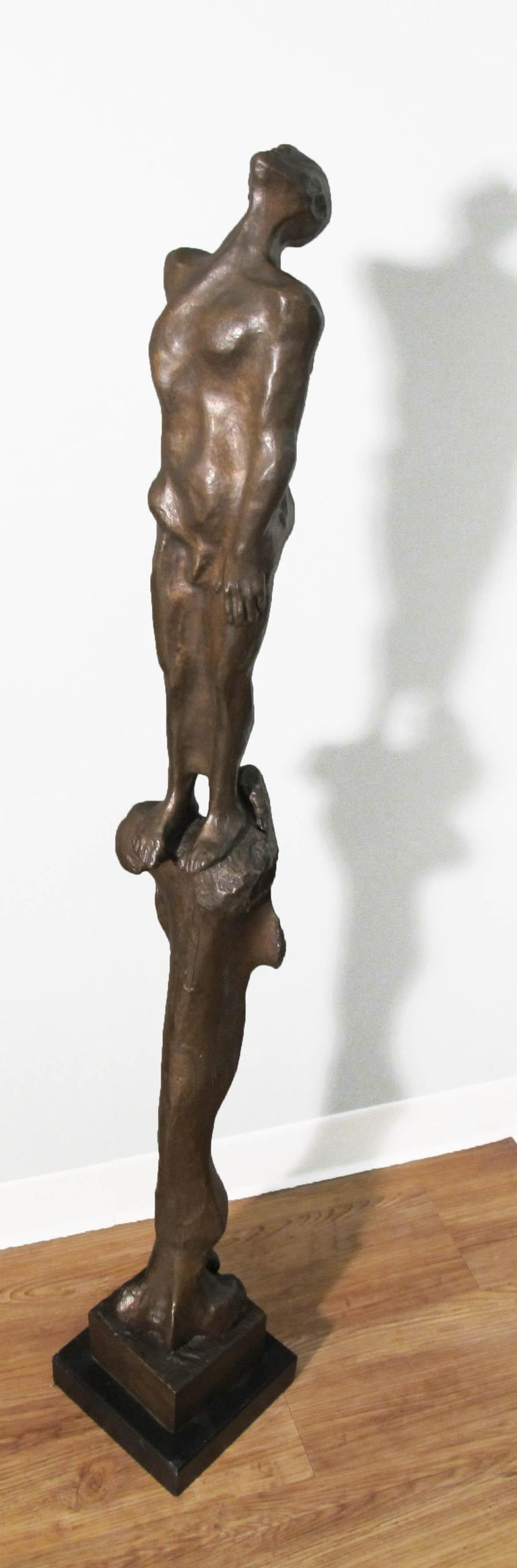 Stylite - Gold Figurative Sculpture by Michael Ayrton
