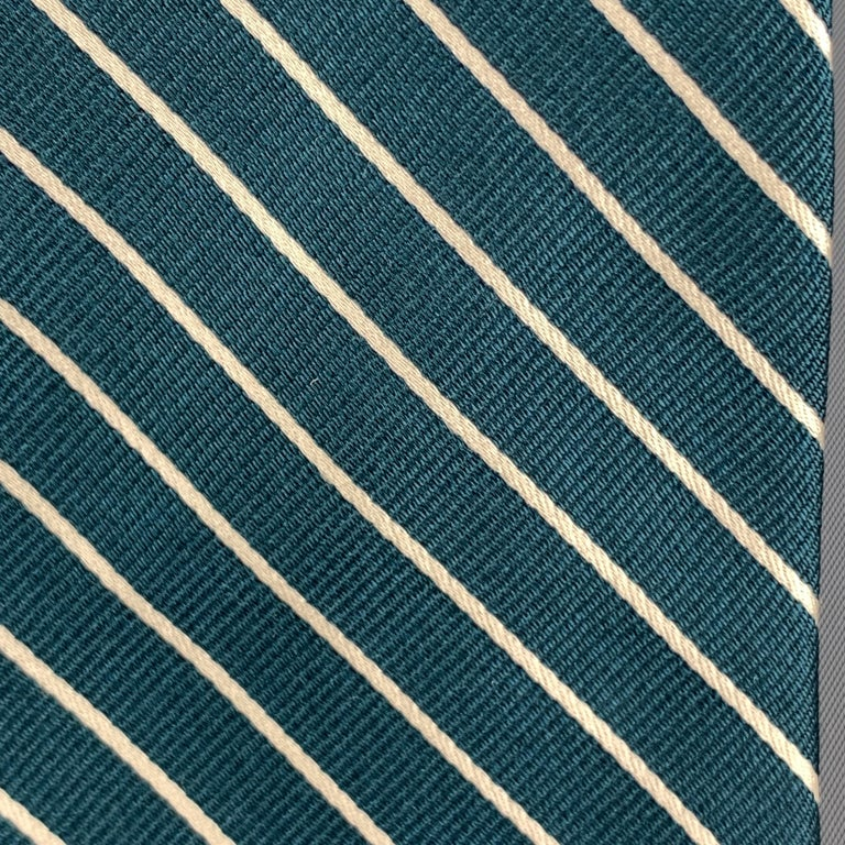 MICHAEL BASTIAN necktie comes in jewel tone green silk with all over diagonal striped print. Made in Italy.  Excellent Pre-Owned Condition.  Width: 3.25 in.