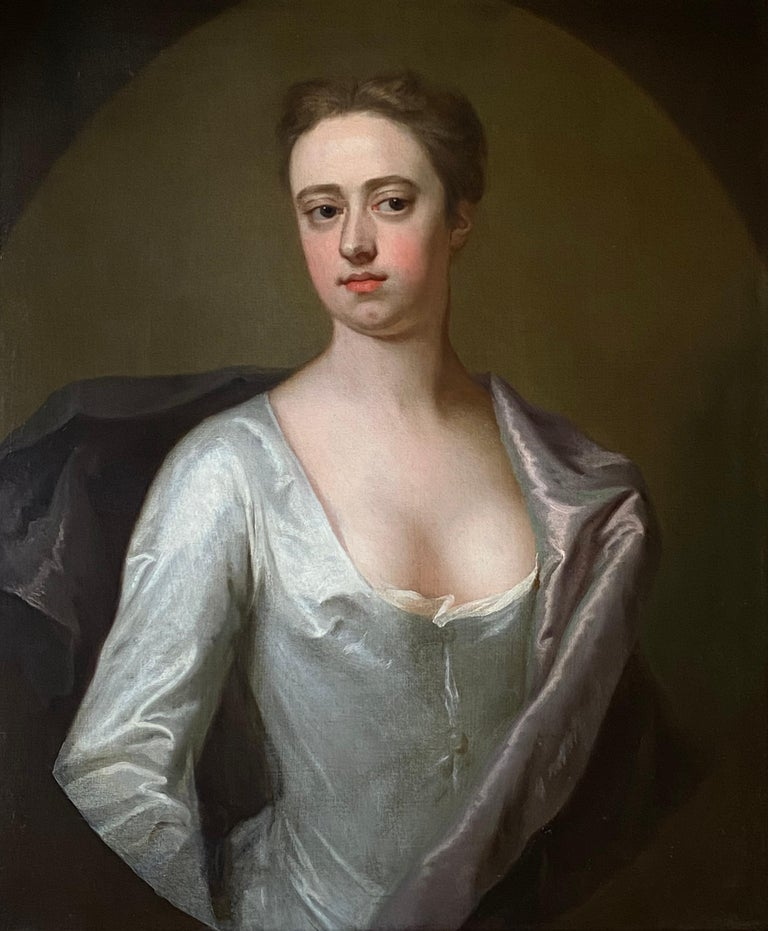 EARLY 18TH CENTURY ENGLISH PORTRAIT OF A LADY IN A WHITE SILK DRESS. - Painting by Michael Dahl