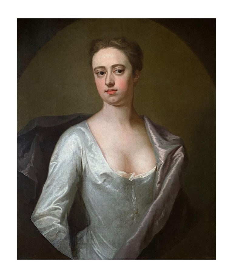 EARLY 18TH CENTURY ENGLISH PORTRAIT OF A LADY IN A WHITE SILK DRESS. - Brown Interior Painting by Michael Dahl
