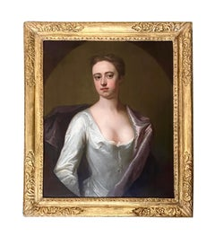 EARLY 18TH CENTURY ENGLISH PORTRAIT OF A LADY IN A WHITE SILK DRESS.