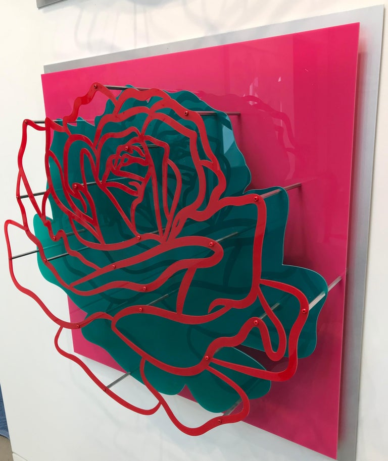 An incredibly dimensional set of four wall sculptures made with multiple layers of laser cut colored acrylic to create each