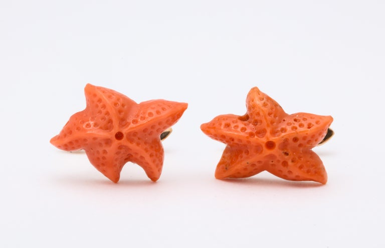 Expert carving makes these wonderful coral starfish appear to jump right from the Mediterranean.  Mounted in a warm 18kt rose gold they are absolutely unique and will add a burst of color and a touch of class to anyone's wardrobe.  The spring backs