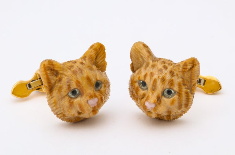 Carved from fossilized palm tree wood and accented with pink opal noses and rock crystal and enamel eyes, these cufflinks are as complex as your favorite feline.  The spring backs are set with the finest lapis-lazuli cabochons and these are