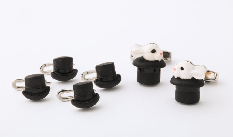 Intricately carved from cocholong and black onyx with enamel accents, these cufflinks and shirt studs are truly magical.  Using the the ancient art of intarsia, the two stones appear as one.  The spring back of the cufflinks even features a matching