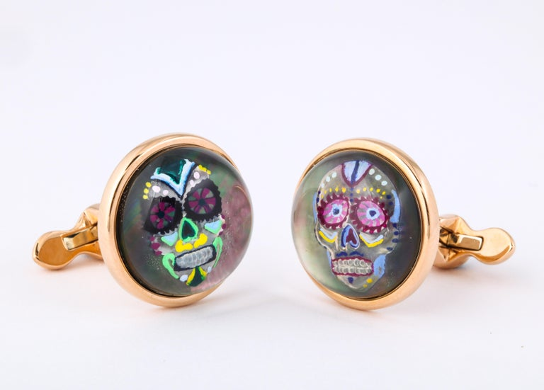 The exceptional detail and artistry is achieved through the use of reverse enameled rock crystal.  This technique begins by carving the design into the underside of a rock crystal quartz cabochon.  The artist then proceeds to enamel the design