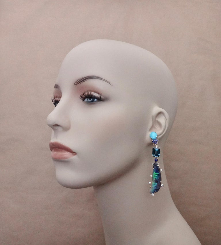 Boulder opals (origin: Queensland, Australia) are featured in these dramatic dangle earrings.