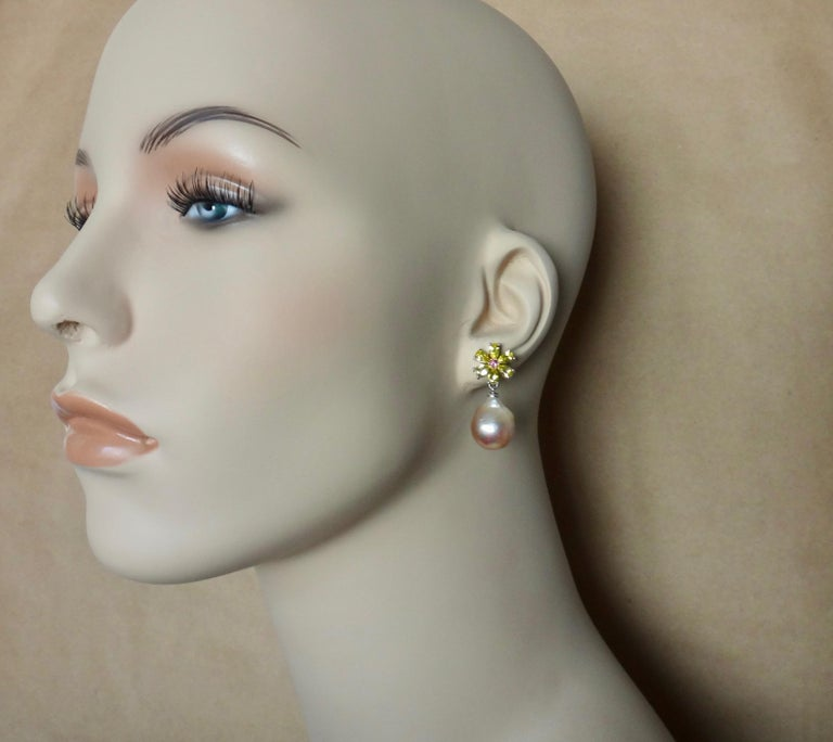 Pear shaped citrine are paired with baroque Kasumi pearls (origin: Japan) in these dainty dangle flower earrings.  The six citrines are a lively lemon yellow and surround bright pink tourmalines.  The colored gems play off the pink pearls with