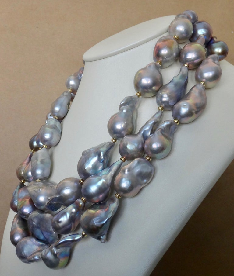 Baroque gray pearls in three graduated strands comprise this sensational necklace.  The 45 pearls range in size from 23mm to a gargantuan size of 31mm.  All the baroque pearls are highly lustrous and reflect a range of colors from shades of blues,