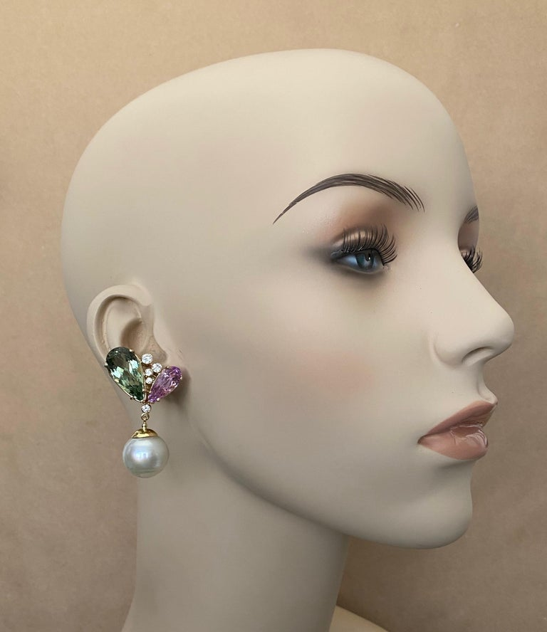 Pear shaped pink kunzite and green hiddenite (origins: Brazil) are paired in these impressive dangle earrings.  Kunzite and hiddenite are related gems, both members of the spodumene family.  All four gems are of optimum color and are very well cut