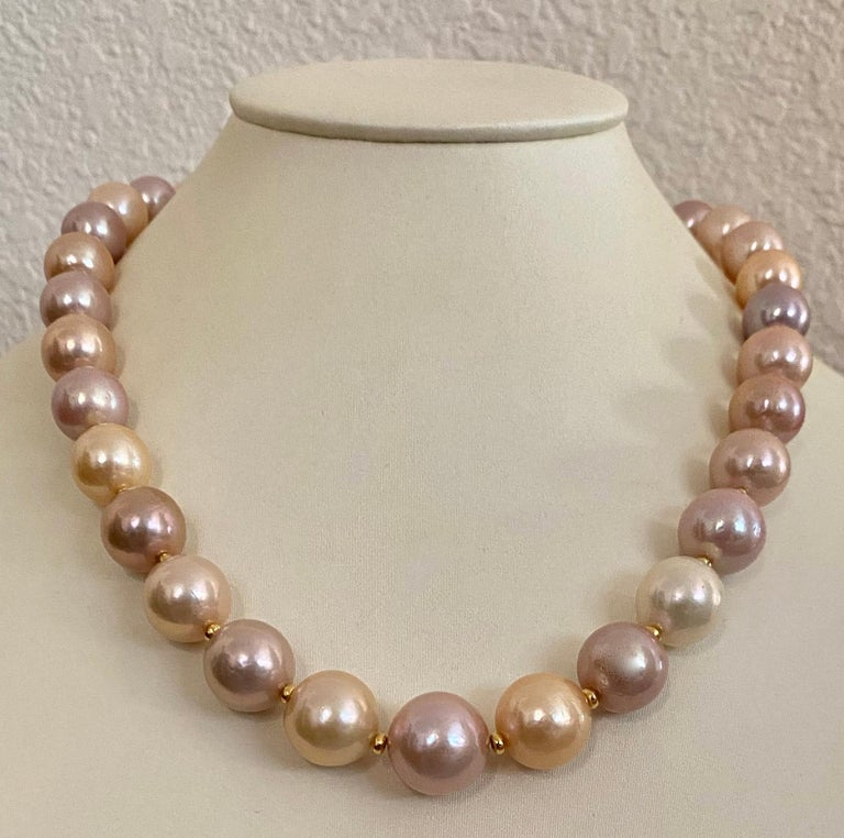 Freshwater pearls in shades of peach, lavender, cream and pink are mixed together to form this superb necklace.  The huge 32 pearls (origin: China) are slightly graduated in size from 1/2 inch to 5/8 inches.  They are blemish free and have rich