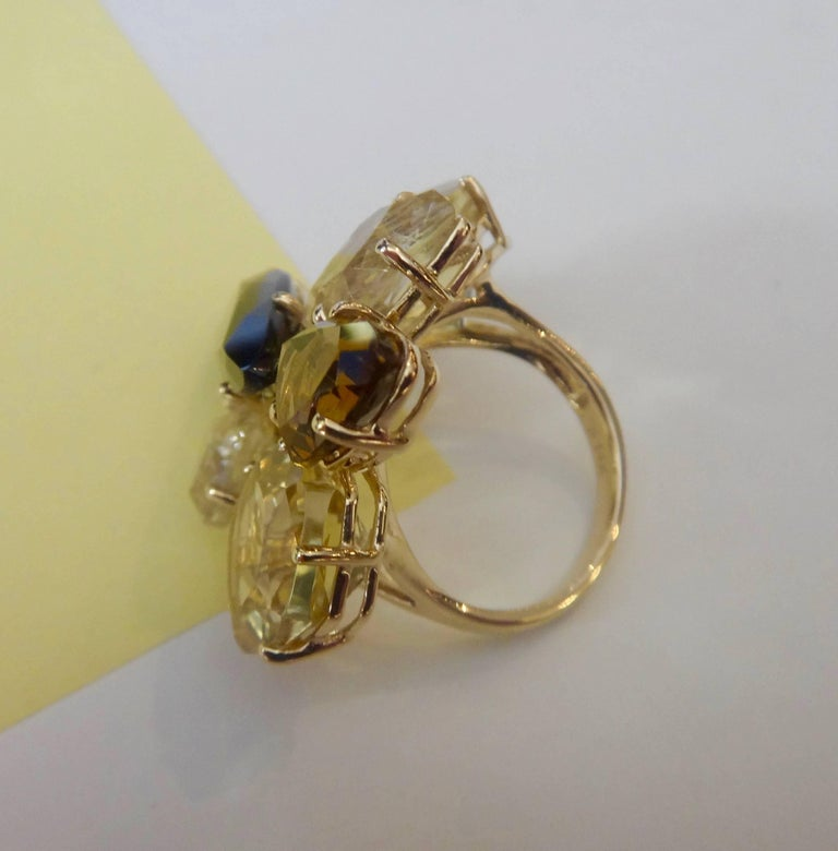 Autumnal colors of yellows and browns in six free form shaped gems of lemon citrine, rutilated and smokey quartz are clustered together in this dramatic cocktail ring.  All prong set in 14k yellow gold.  Ring size 7 and may be easily sized.  PLEASE
