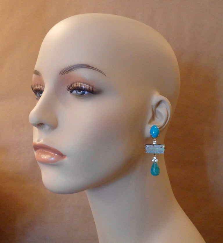Sleeping Beauty turquoise forms the anchors for these monochromatic dangle earrings.  Complimenting the turquoise are brilliant cut blue zircons (Myanmar), Boulder Opals (Boulder opal is one of the most valuable varieties of opal, second only to