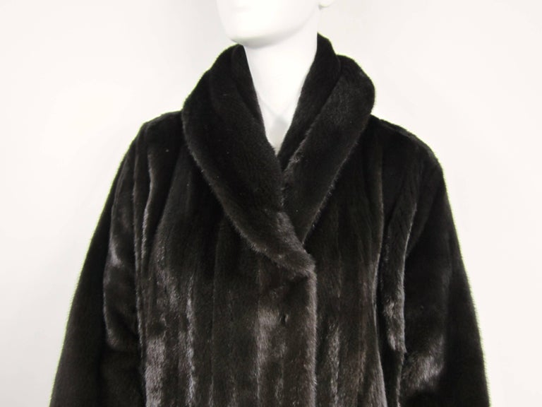 Stunning Michael Kors Ranch Mink, velvet lined slit pockets with a Large collar. 2 pockets. Mink is Soft and supple Mink Retails New $15,000.00 Measuring approximately 48 in Bust,  48 in Waist, 48.5 inches long, 9.5 in collar unfolded. Will fit a