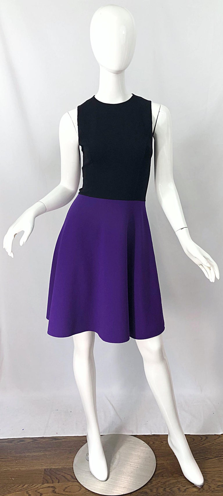 Wonderful mid 2000s $1,850 MICHAEL KORS COLLECTION black and purple color block sleeveless A -Line / Skater dress! Features a tailored bodice with a full skirt. Hidden zipper up the back with hook-and-eye closure. Can easily work for day or evening
