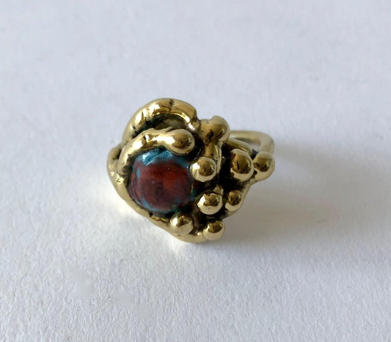 Handmade bronze ring with fused glass stone created by artist and sculptor Michael Schwade of West Fork, Arkansas.  Ring is a finger size 9 and is unsigned.  suitable for a man or woman. In very good condition and unsigned.  I have more great rings